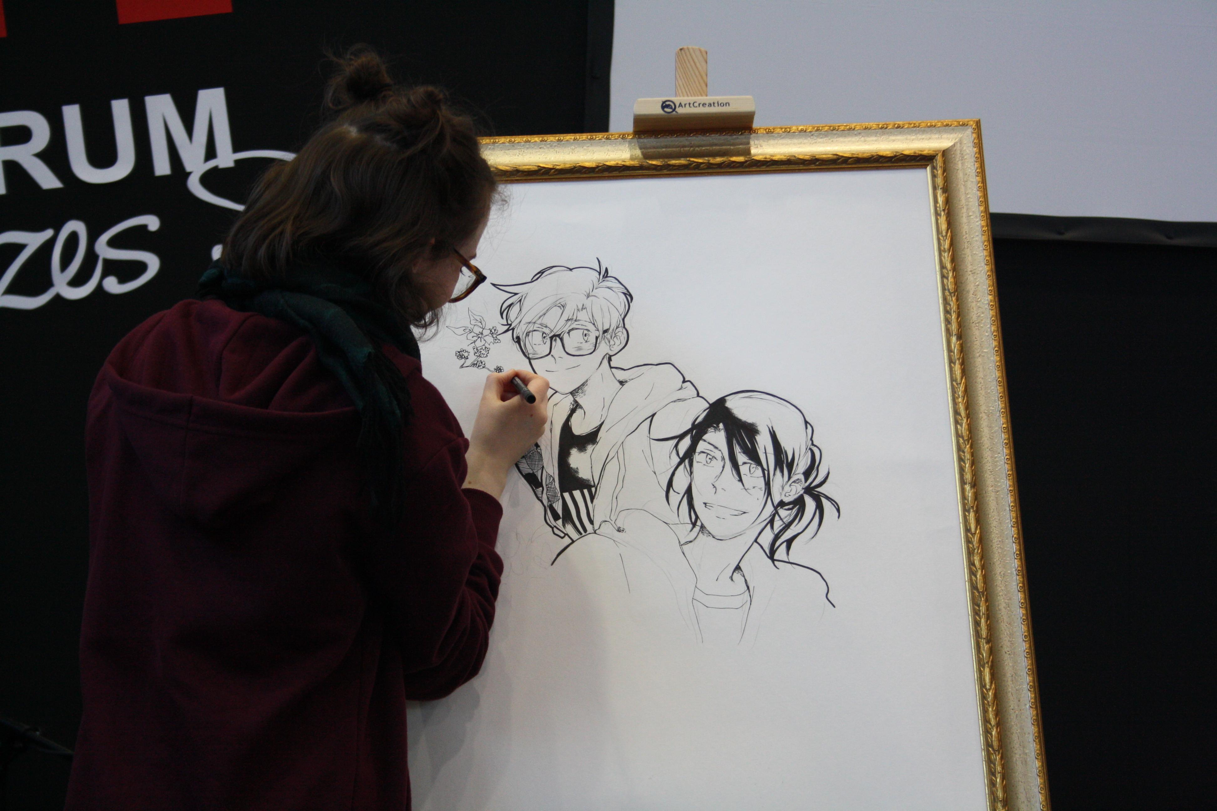 Anna beim Live-Zeichnen der Hauptcharaktere. © Alexandra Schmidt